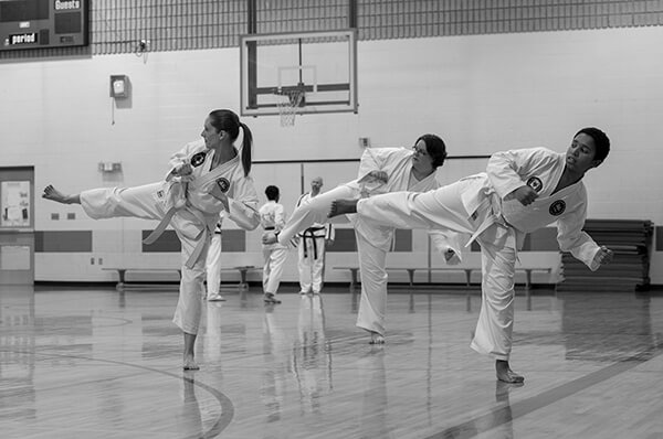 Adult students training with Estevan TKD